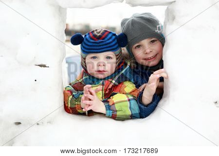 Two Children In Snow House