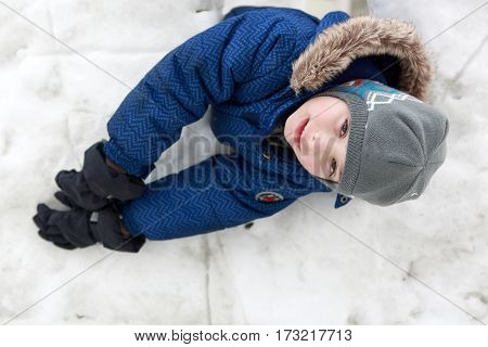 Boy In Snow House