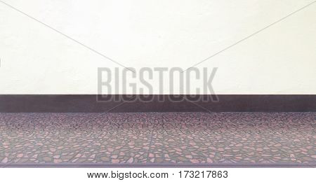 Empty room with white concrete background and gravel tile floor.Minimalist interior
