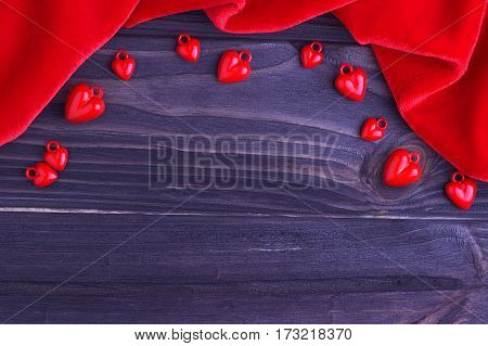Valentine's Day Elegant Background Red Hearts And Red Fabric On Wooden Background. Wedding.
