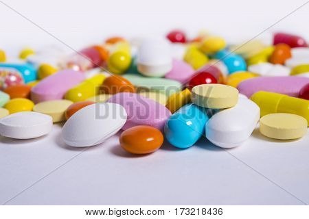 Multicolored Pills And Tablets On White Background