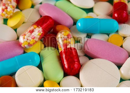 Multicolored Pills And Tablets. Red, Blue, Yellow, Pink Colors.