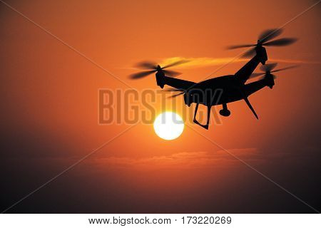 Backlit drone at sunset. Surveillance concept. 3D Rendering
