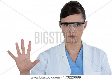 Beautiful female scientist using digital screen against white background