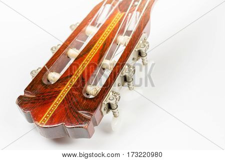 Head Of The Acoustic Guitar Over White Background With Copy Spac
