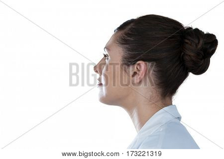 Side view of thoughtful female scientist looking away against white background