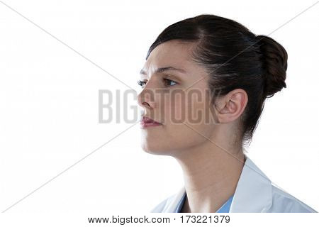 Close-up of thoughtful female scientist looking away against white background