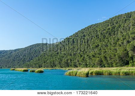Krka national park Croatia - May 05 2016: Krka river and forested hills