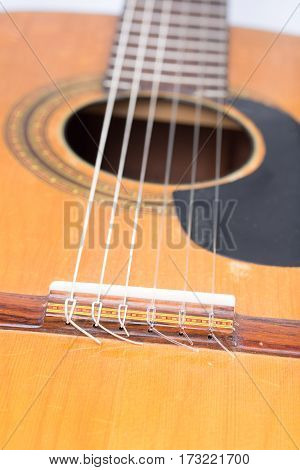 Acoustic Guitar Bridge With Blurred Background