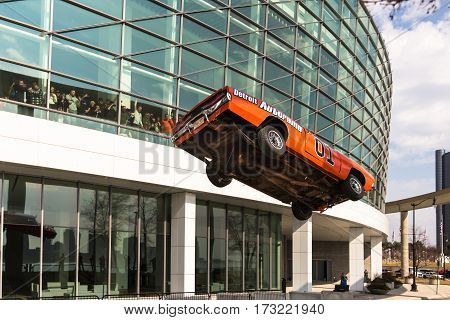 DETROIT MI/USA - February 24 2017: The General Lee car, a Dodge Charger from the Dukes of Hazzard TV show, airborn in a stunt jump in front of Cobo Center at the Detroit Autorama hot rod show.