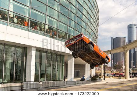 DETROIT MI/USA - February 24 2017: The General Lee car, a Dodge Charger from the Dukes of Hazzard TV show, airborn in a stunt jump in front of Cobo and Renaissance Centers at the Detroit Autorama.