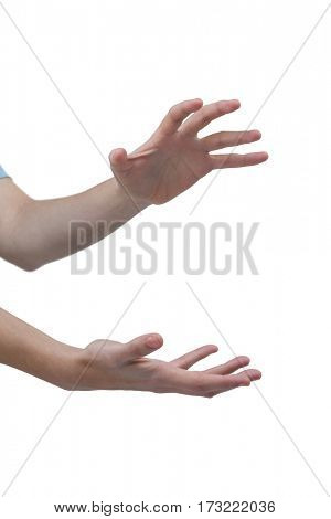 Close-up of hands gesturing against white background