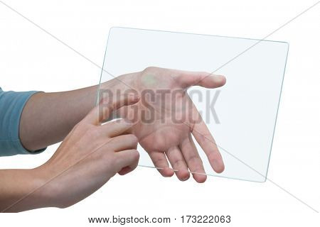 Hands of businesswoman pretending to use digital tablet against white background