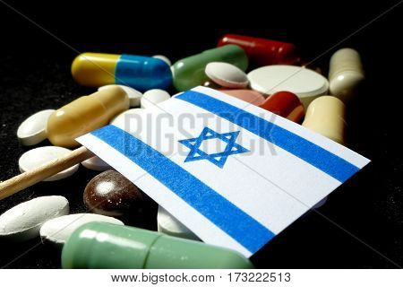 Israeli Flag With Lot Of Medical Pills Isolated On Black Background