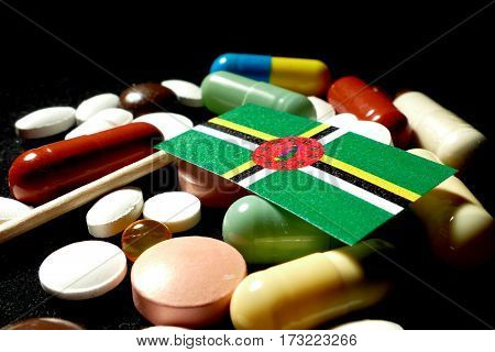 Dominican Flag With Lot Of Medical Pills Isolated On Black Background