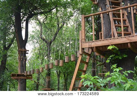 Adventure climbing high wire park. An adventure park is a place which can contain a wide variety of elements such as rope climbing exercises obstacle courses and zip-lines.