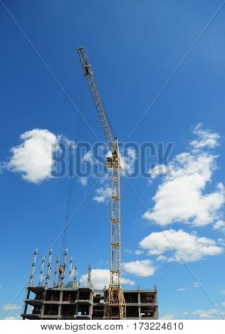 Crane Construction. Tower Crane in Construction site. Yellow crane building high rise. Economic Development.