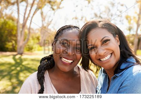 Portrait Of Mother And Adult Daughter In Park Together