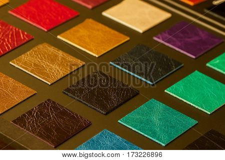 Colorful leather samples on dark background, choice of texture and color