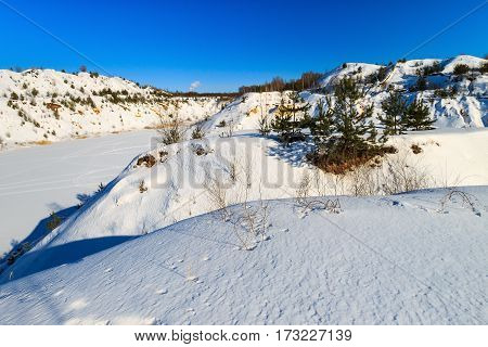 Hills Covered With Snow In Winter With Pines And Trees.