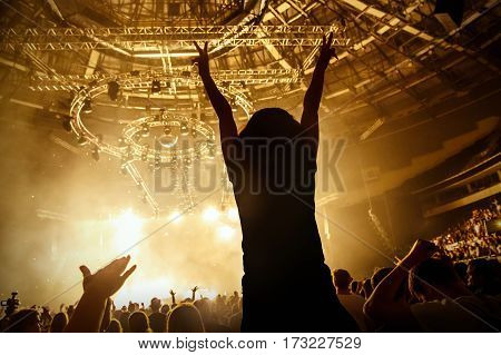 Black silhouette of happy girl on rock concert