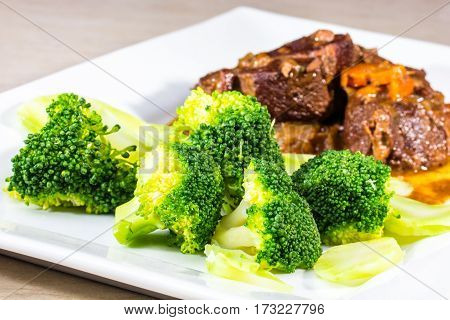 Stew With Vegetables Meat With Broccoli Is On The Plate.