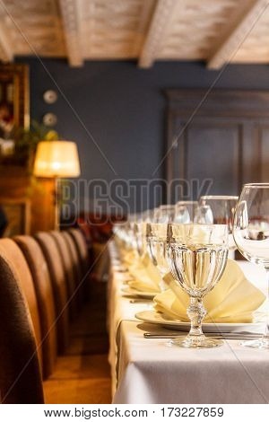 One Sharp Glass In A Number Of Dishes On The Table For A Banquet.