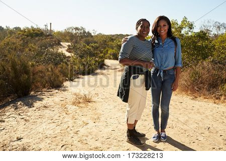 Portrait Of Mother And Adult Daughter Hiking In Countryside
