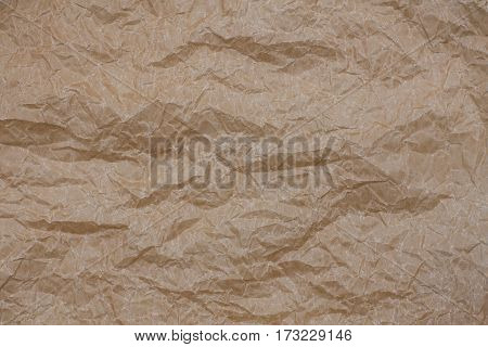 Wrinkled kraft paper. Top view brown crumpled paper background texture