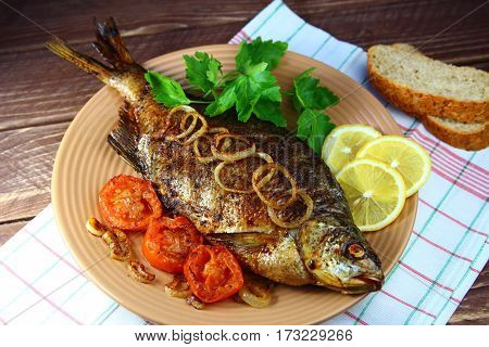 bream baked with onions and tomatoes with lemon and parsley