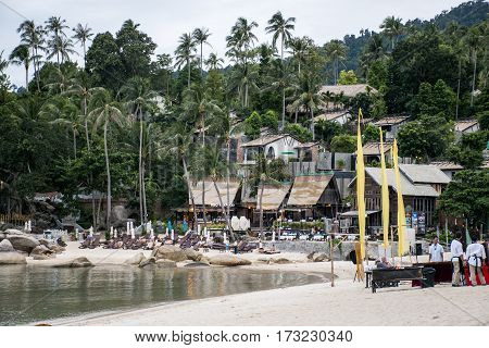 25.09.2015 Koh Phangan Thailand Tropical Island beach paradise Thong Nai Pan Bay People sitting eating