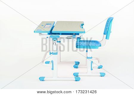 Blue chair and school table on the white isolated background.