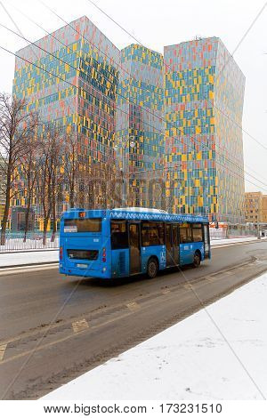 Moscow Russia February 17 2017: Bus blue on a background of colorful buildings.