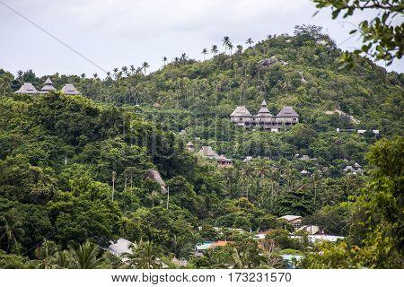 Beautiful tropical coast line Koh Phangan Thailand green palms and houses
