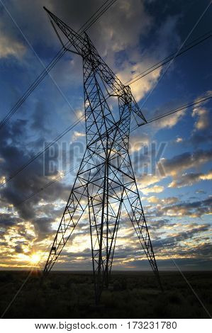 Landscape of power lines for electricity metal towers and sunset