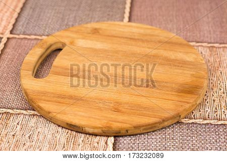 Wooden Round Cutting Board On The Table