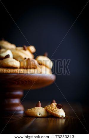 sweet homemade cookies on a dark wooden table