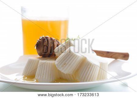 sweet dessert panna cotta with honey on a white background