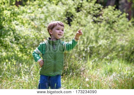 Five Year Old Boy Looking And Pointing His Finger At The Strange