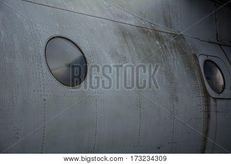 Vintage old airplane porthole close up background
