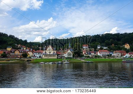 STADT WEHLEN. GERMANY - AUGUST 04 2016: A view to Stadt Wehlen and Elbe river on a summer day.
