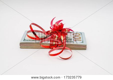 American currency tied with a red ribbon pack