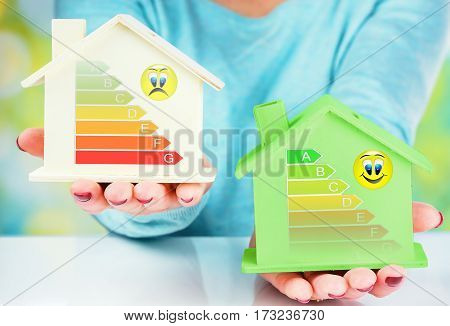 concept comparison between normal house and low consumption house with energy efficiency rating poster