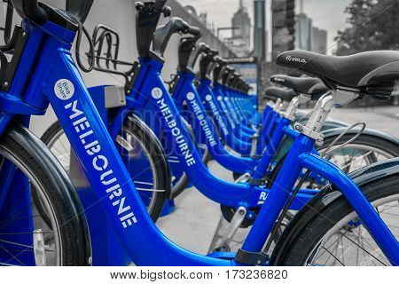 Melbourne Australia - December 27 2016: Bike share station located at Queensbridge Square in CBD. People can hire bikes and explore the city. Selective color effect.