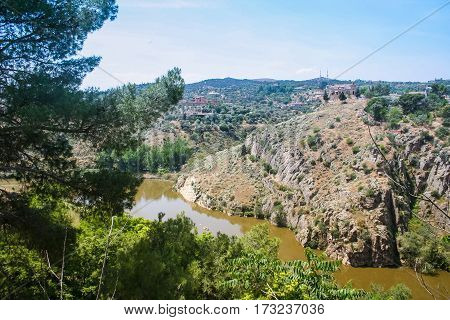 Tajo -- largest river in the Iberian Peninsula. Originates in Spain and flows into the Atlantic ocean near Lisbon. The city of Toledo in Spain (the Ancient capital of Spain). May 2006
