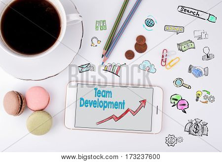 Team Development, Business Concept. Mobile phone and coffee cup on a white office desk