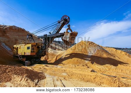 Sand quarry near the town of Orikhiv in Zaporizhzhia region of Ukraine. Excavator  electric power shovel   with bucket capacity of five cubic meters. September 2006