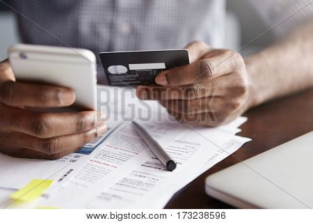 Online Payment And Shopping Concept. Cropped Shot Of African-american Male Holding Cell Phone In One