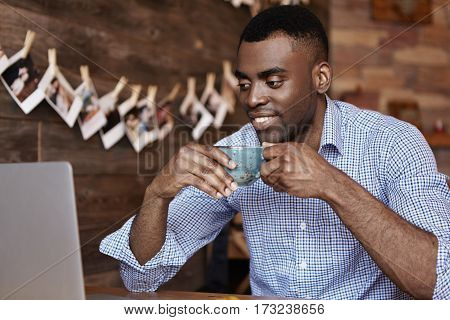 Modern Technology, People And Leisure Concept. Candid Shot Of Attractive Young African-american Male