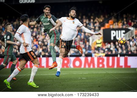 VALENCIA, SPAIN - FEBRUARY 19: (R) Garay and Garcia in the air during La Liga soccer match between Valencia CF and CD Athletic Club Bilbao at Mestalla Stadium on February 19, 2017 in Valencia, Spain